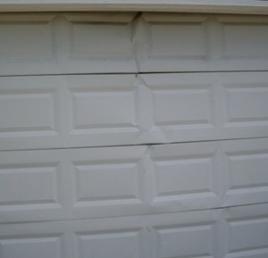 cracked-garage-door-panels-Kansas-City